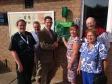 Jonathan Djanogly MP cutting the ribbon of Alconbury's new defibrillator with Lorna Hayes, the Community First Responder Manager
