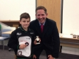 Jonathan presenting Louis with his super badger award at the St John Ambulance awards ceremony.