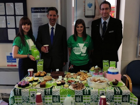 Jonathan enjoying coffee and cake at the Macmillan Coffee morning hosted by staff at Barclays Bank in Huntingdon.