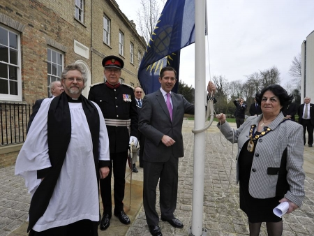 Jonathan raising the Commonwealth flag at the Huntingdonshire District Council offices (Photo by The Hunts Post)