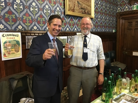 Jonathan with Tony Hobbs of Cromwell Cider promoting local produce at Parliament's Cambridgeshire Food Day.