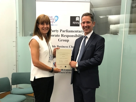 Jonathan Djanogly presents a Corporate Responsibility certificate to Helen Dighton of Huntingdon based Encocam
