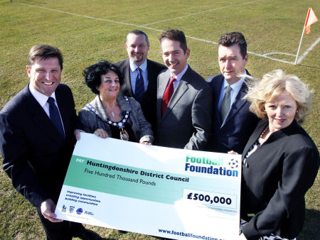 Jonathan presents a Football Foundation cheque to Councillors and officers for improvements at One Leisure St Ives Outdoor