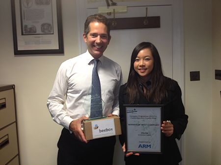 Jonathan Djanogly congratulates Jessica Tang member of Kimbolton School's winning Young Enterprise team