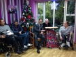 Jonathan joining residents of Leonard Cheshire's Brampton home for their Christmas celebrations
