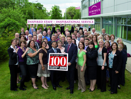 With staff at the Luminus Group presenting an award for being in The Times Top 100 Best Companies to Work For