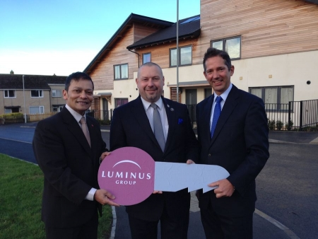 Jonathan Djanogly with Chan Abraham and Cllr Jason Ablewhite marking the completion of new affordable homes in Thongsley, Huntin