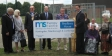 Jonathan Djanogly unveiling the new sign at the MS Therapy Centre in Huntingdon recently.