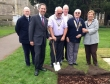 Jonathan commemorating International Polio Eradication Day by planting purple crocuses at St Neots Parish Church.
