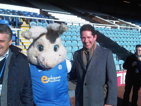 Jonathan Djanogly with Peterborough United's mascot