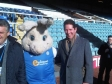 Jonathan Djanogly with Peterborough United's mascot