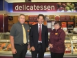 Jonathan Djanogly with workers at Sainsbury's Huntingdon store