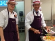Jonathan Djanogly making pizza with Alex during a visit to Sainsbury's Huntingdon store.