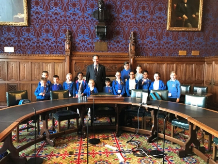 Jonathan welcoming pupils from St John's Primary School, Huntingdon to the House of Commons