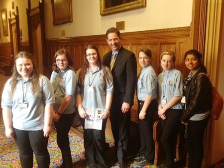 Jonathan Djanogly with pupils from St Peter's School who met their MP to talk about the Cambridgeshire Kick Ash campaign