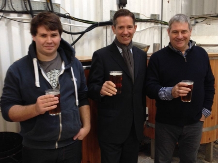 Jonathan Djanogly takes part in a 'mash in' of 'MP's Brew' at The Red Brewery