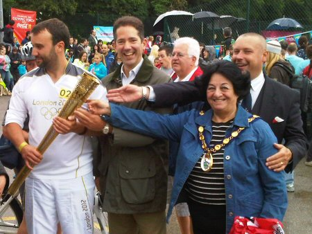 Jonathan is pictured welcoming the Olympic Torch to Huntingdon on Sunday 8 July.